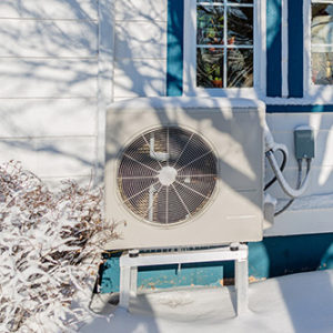 11air source heat pump outside in the snow