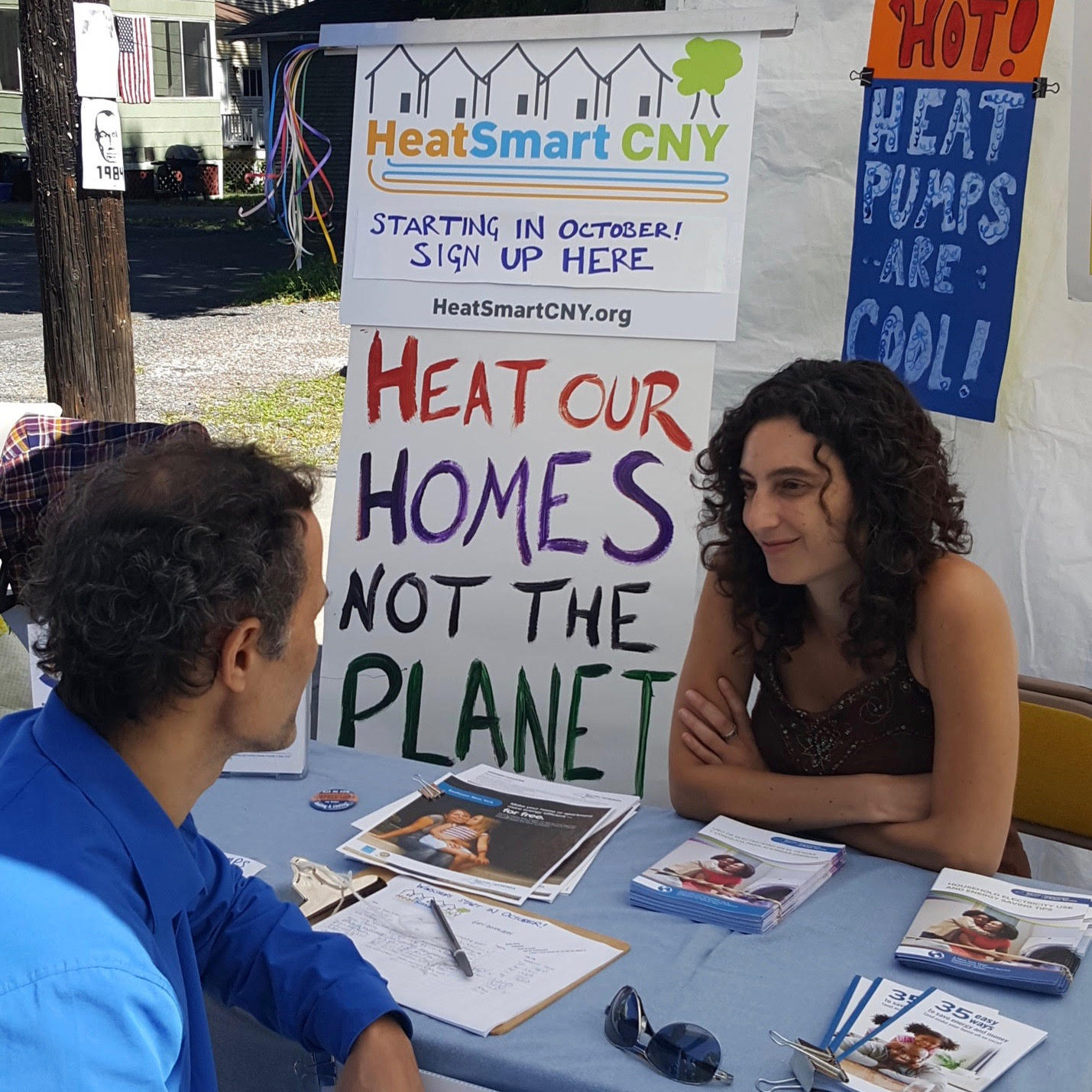 staff and volunteers at a heat smart cny information table