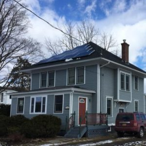 exterior of mcclure residence in winter with roof solar panels